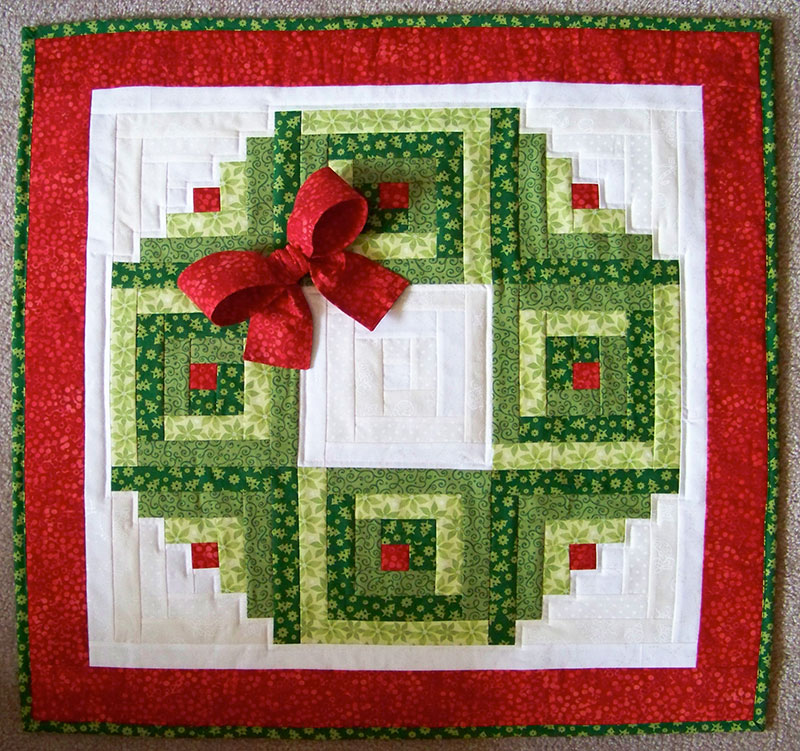 This pattern uses 3 greens and 3 whites, and red for the berries and border; plus a 3D bow, berries and leaves. For my version I crafted a more modern twist ...